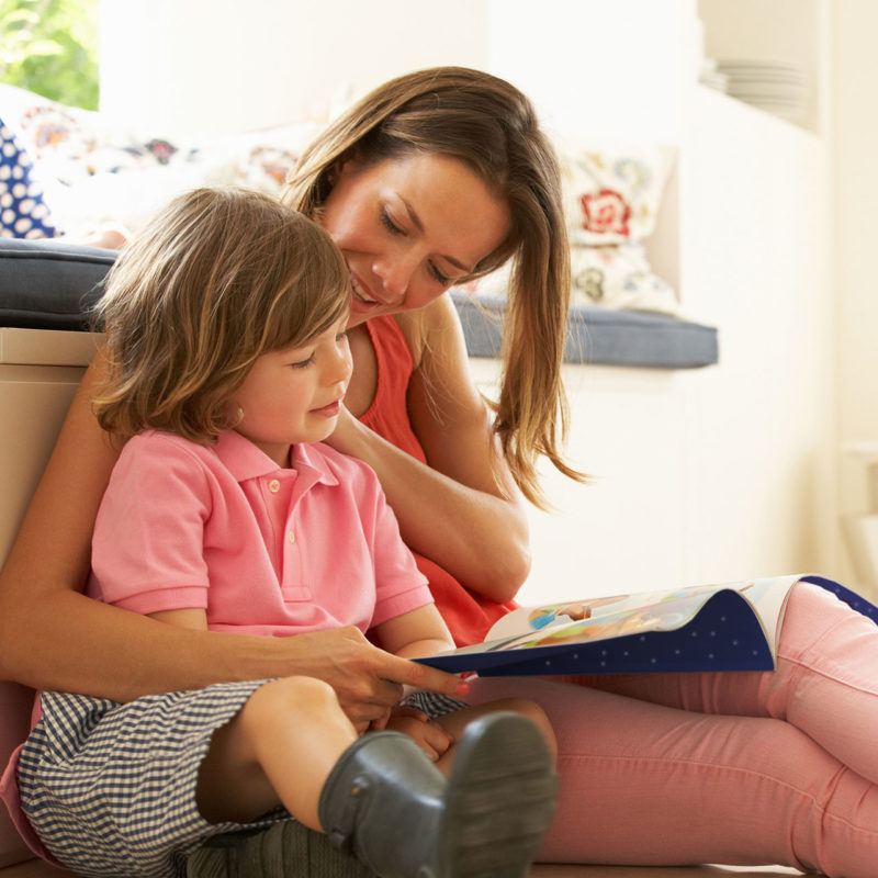 Mum and child reading Santa Socks Christmas Adventure book
