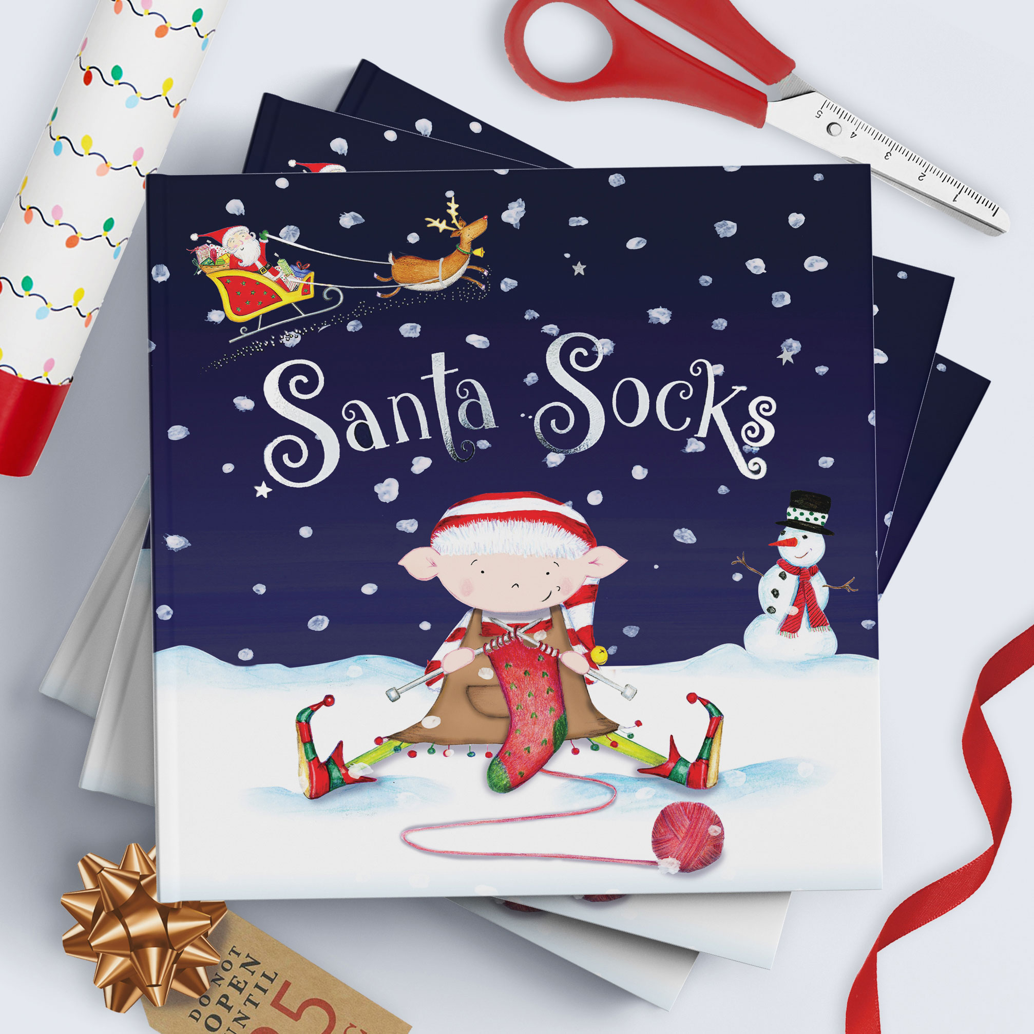 Santa Socks personalised Christmas adventure books stacked ready for wrapping